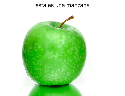 "Photo of apple with ""this is an apple"" in Spanish"